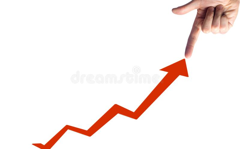 A finger points to a graph of a sustainable development concept, a concept with a chart going up showing growth, profit or success stock illustration