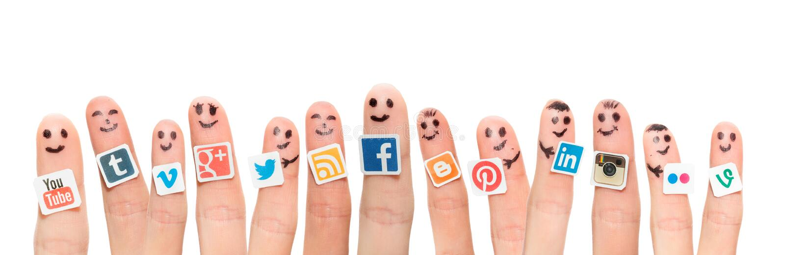 Finger with popular social media logos printed on paper. stock image