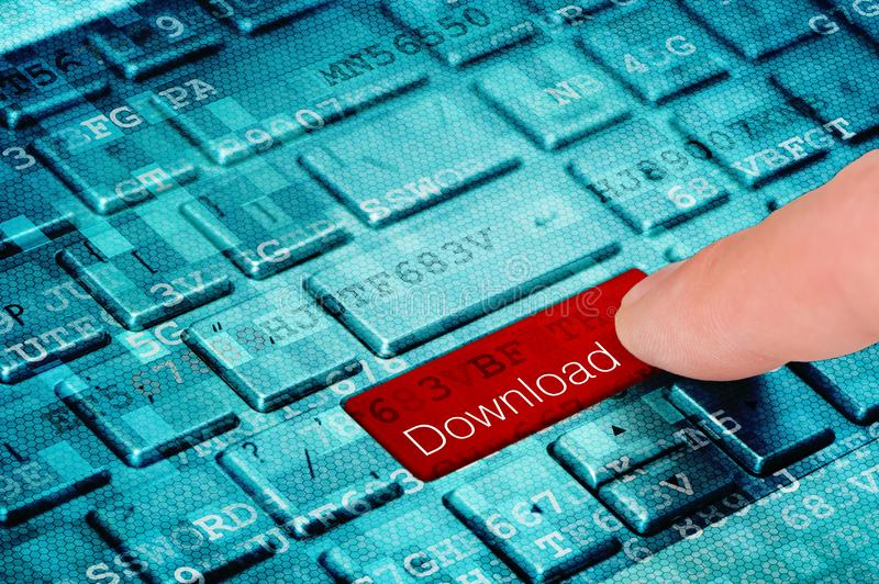 A finger press red download button on blue laptop keyboard royalty free stock photo