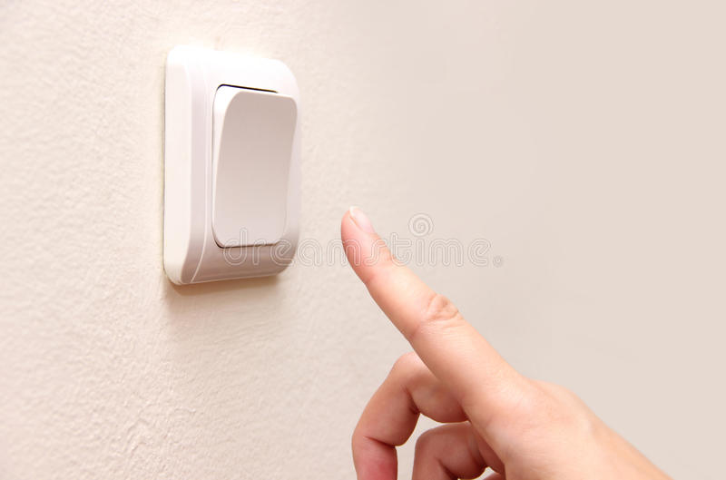 Finger press turn off. Electrical switch stock photos