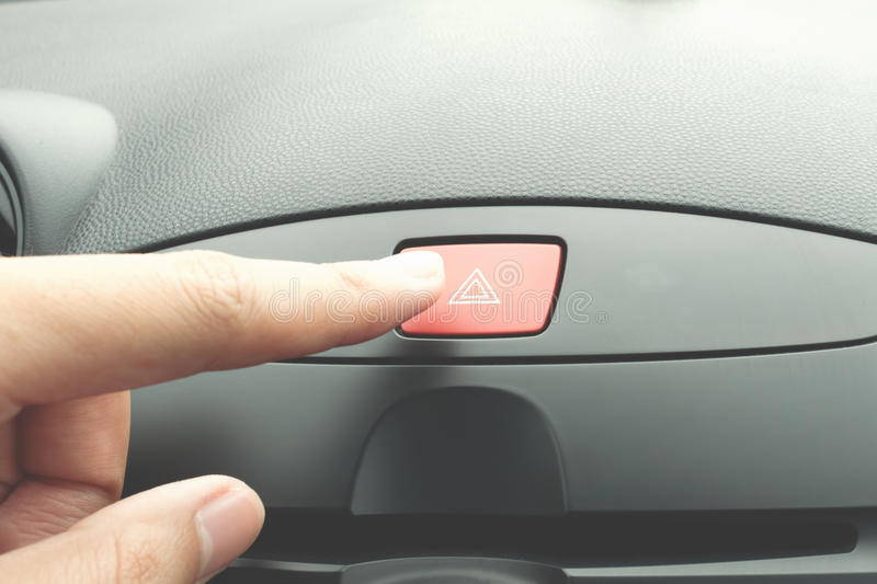 Finger pressing car emergency button. Finger pressing red car emergency button stock images