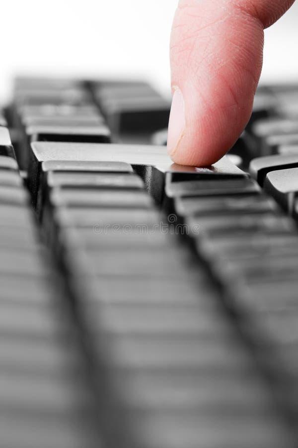 Download Finger pressing key stock photo. Image of keypad, business - 18697568
