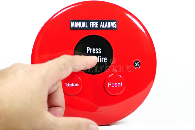 Finger pressing on manual fire alarm royalty free stock image