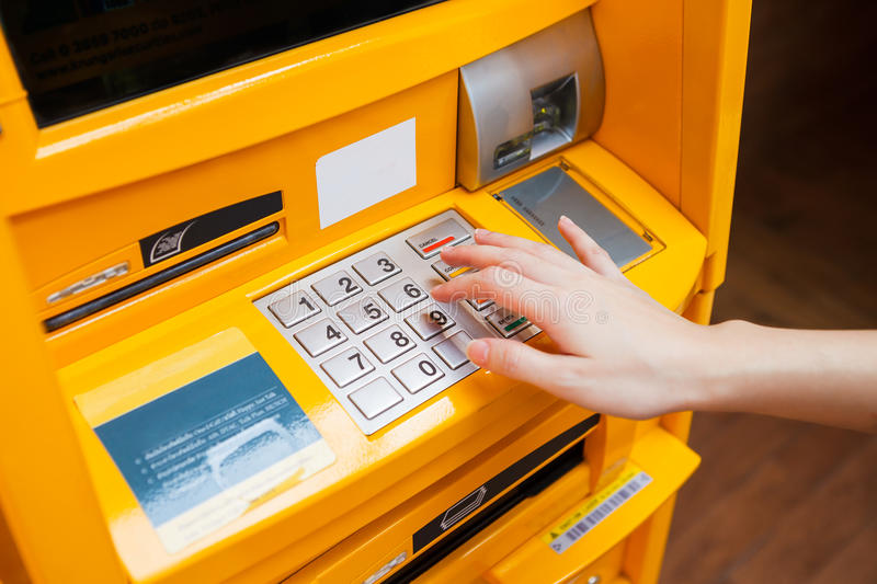 Finger pressing password. Number on ATM machine stock image