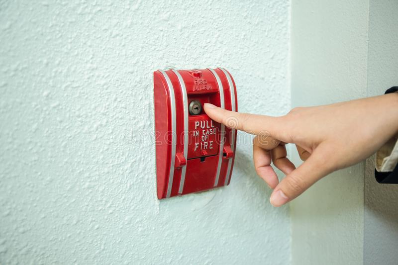 Finger pull fire alarm tool. On wall due to emergency with copy space royalty free stock images