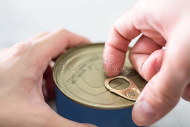 Finger pull opening loop of canned food stock images