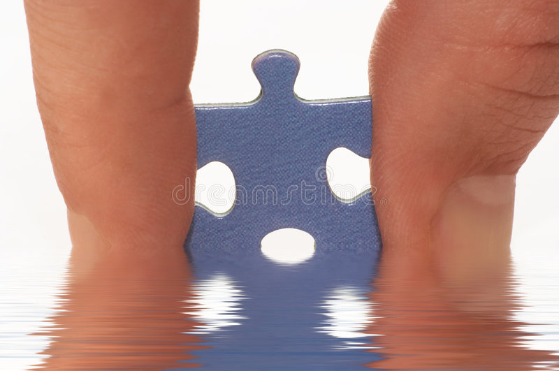 Finger And Puzzle In Water Stock Images