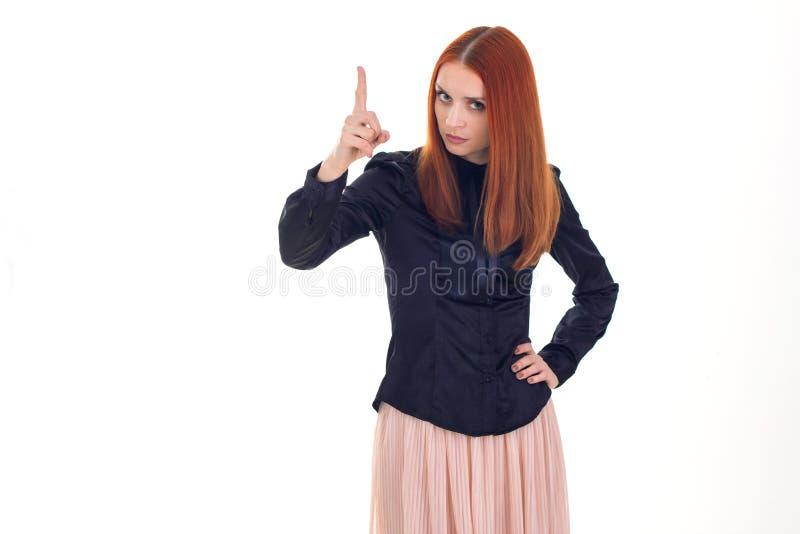 Finger que amenaza de la mujer hermosa del pelirrojo fotos de archivo