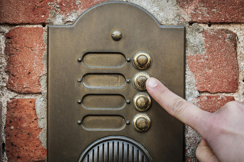 Finger ringing a door bell royalty free stock photo