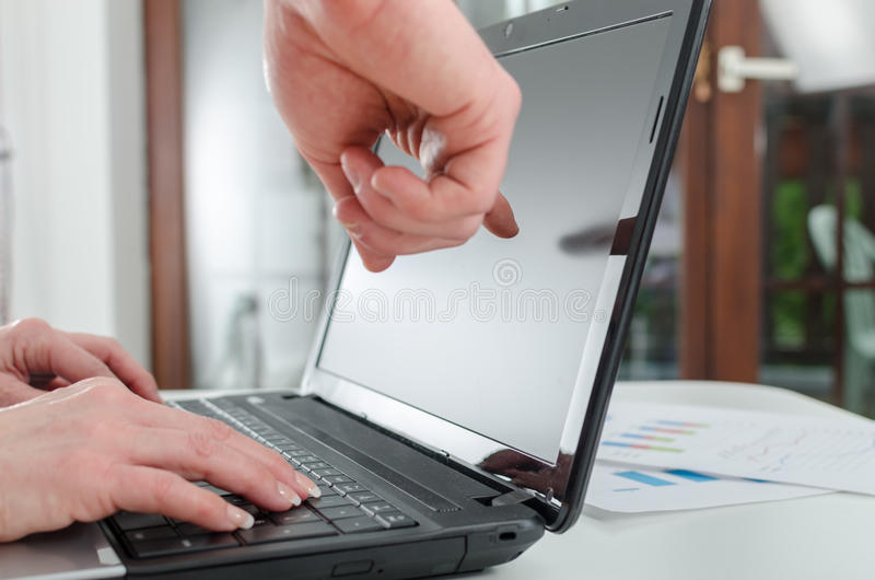Finger showing laptop screen. At the office royalty free stock image