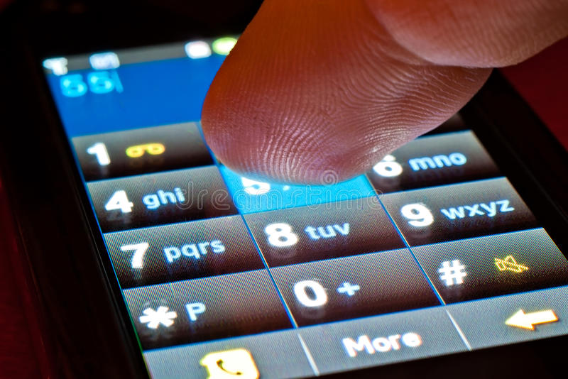 Finger on smartphone. Finger dialing on touch screen smartphone