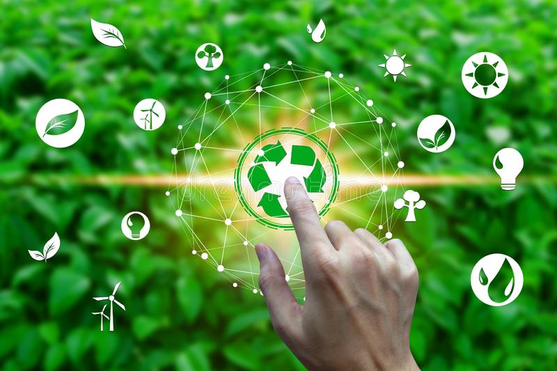 Finger touch with environment icons over the Network connection on nature background, Technology ecology concept.  royalty free stock image