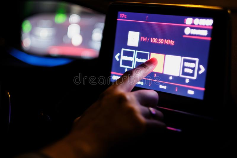 Finger on the touch screen. Of the computer in the car royalty free stock photos