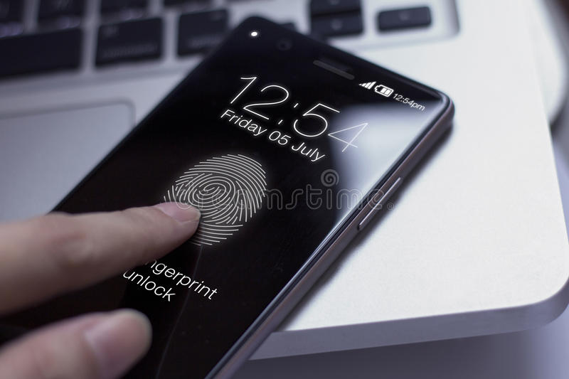 Finger touching smartphone to unlock screen. royalty free stock photo