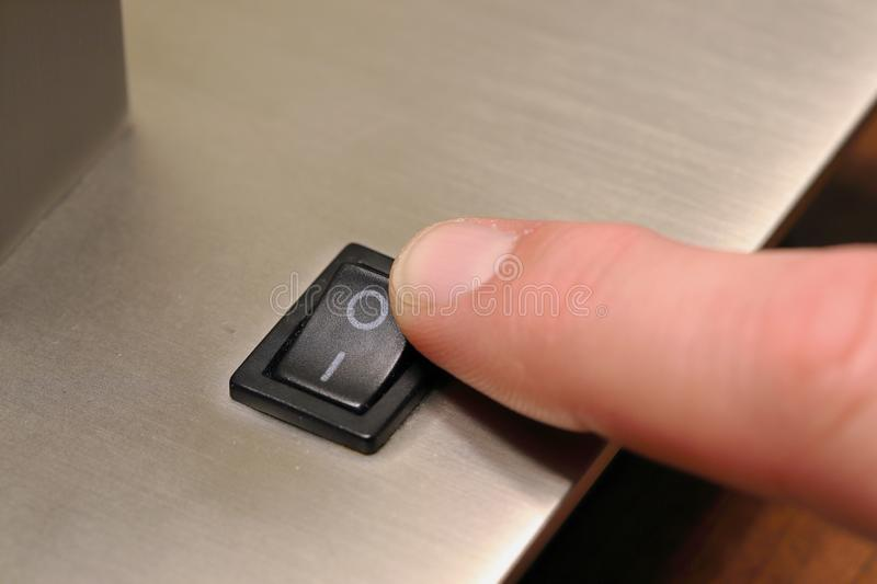 Finger turning switch off for lamp stock photos