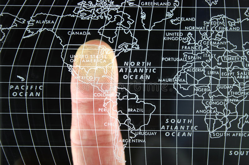 Finger on world Map. Single finger on world lmap pointing at the USA with Fingerprint overlay stock photos
