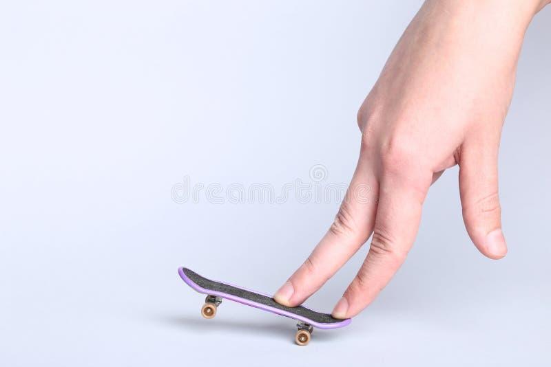 Fingerboard- und Handfinger stockbilder
