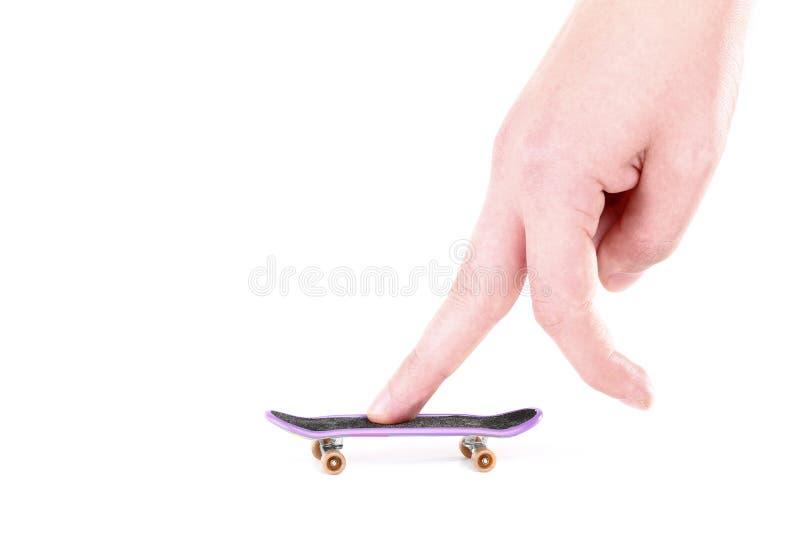 Fingerboard- und Handfinger lizenzfreie stockbilder
