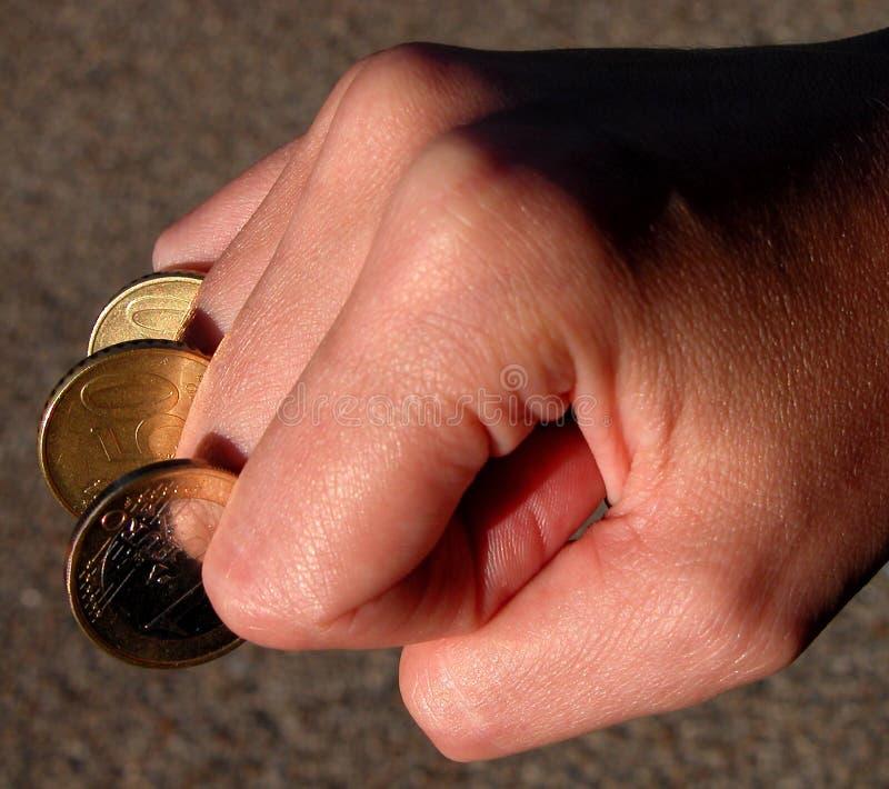 fingercoinspengarström royaltyfri bild