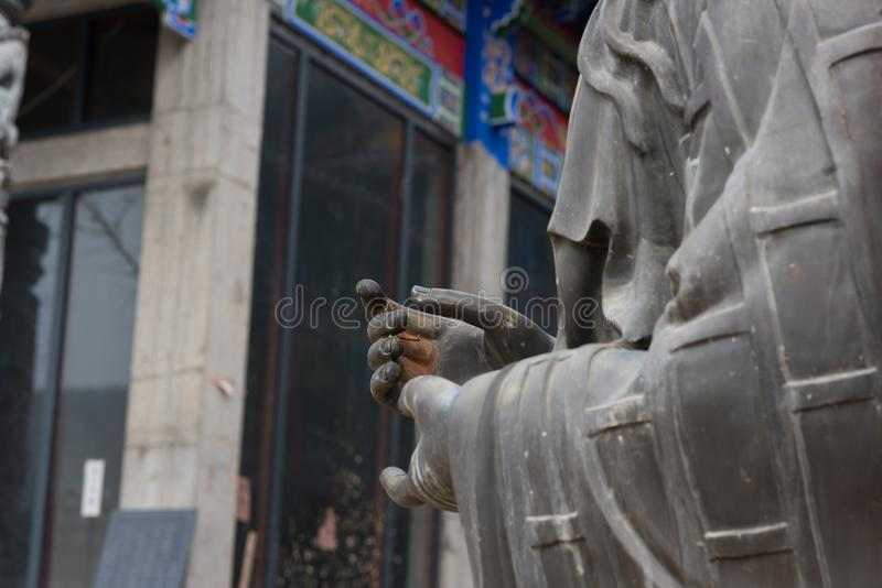 Fingered citron. Ancient chinese fingered citron Part of the details of the statue of Buddha stock image
