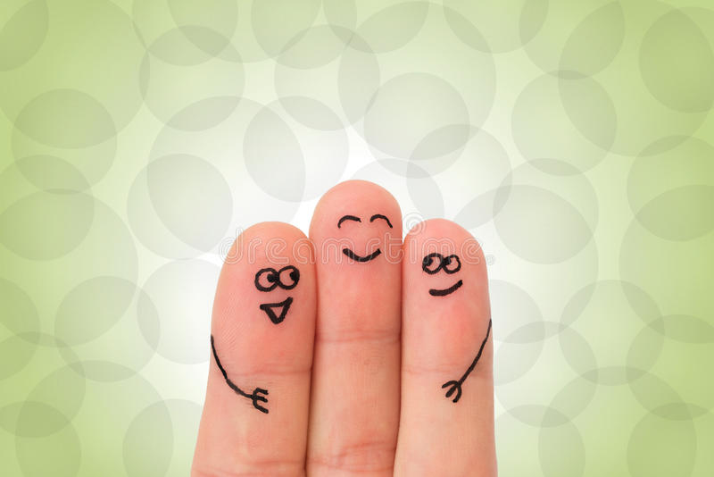 Fingeres que abrazan con las caras imágenes de archivo libres de regalías