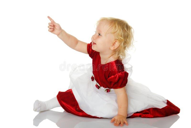 fingerflicka little som pekar fotografering för bildbyråer