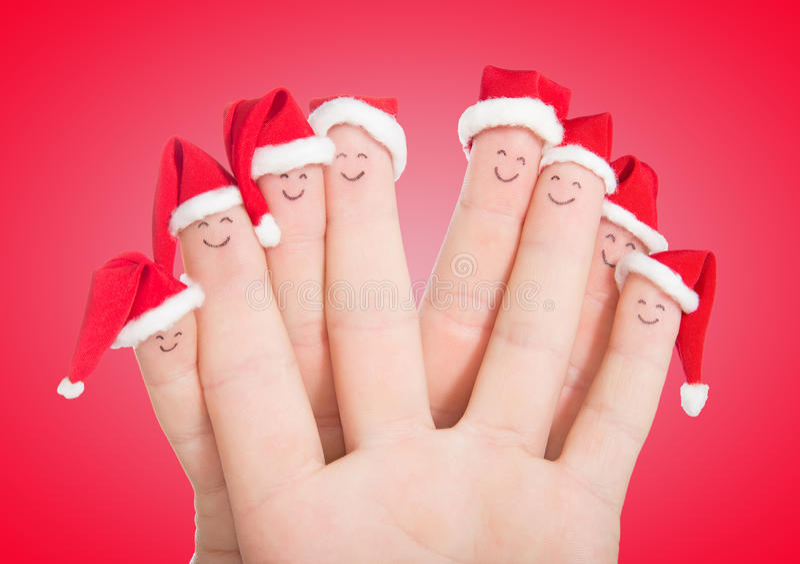 Fingergesichter in Sankt-Hüten Glückliche feiernde Familie stockbild