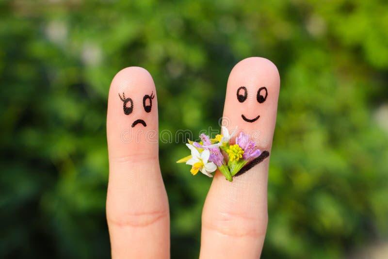 Fingerkunst von Paaren Mann gibt Frauenblumen, sie ist nicht erfüllt stockfoto