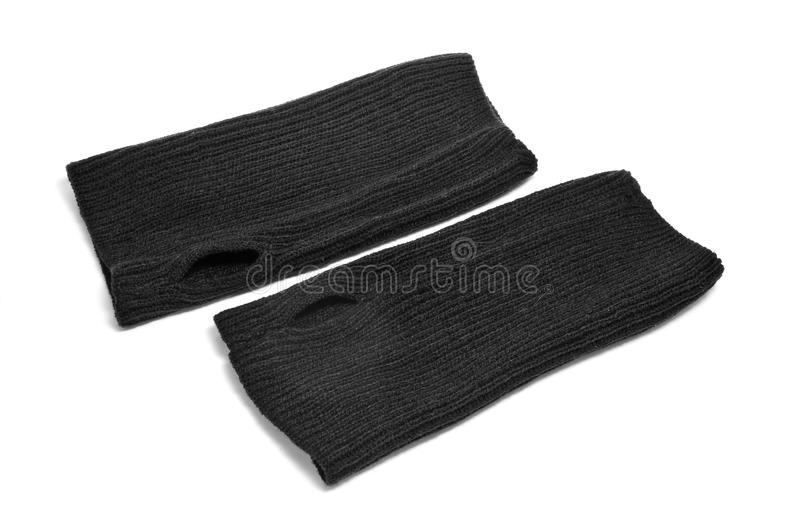 Fingerless gloves. A pair of black fingerless gloves on a white background stock photos