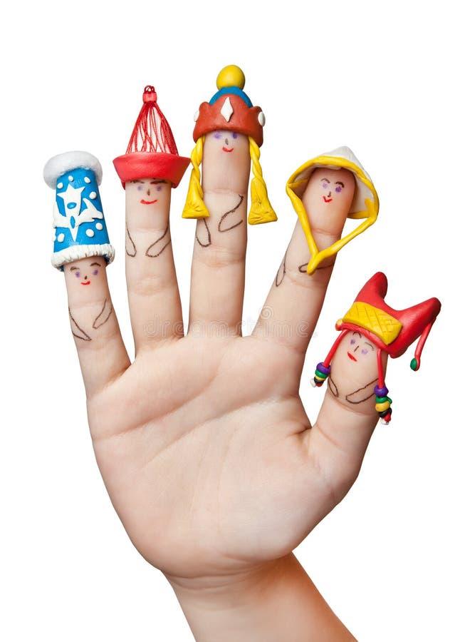 Fingermann-Hutvölker der Welt an Hand Kind-` s Kreativität lizenzfreie stockfotografie