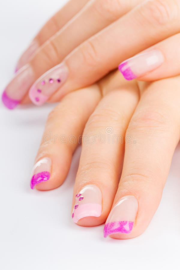 Fingernails. Coloured pink female fingernails on white ground royalty free stock photo
