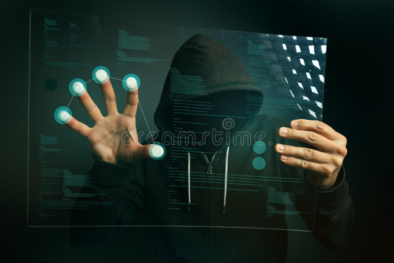 Fingerprint identification app on futuristic tablet computer device. Hooded computer hacker hacking biometric security internet system royalty free stock image