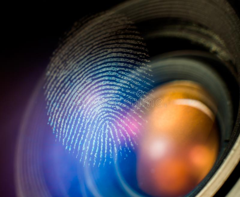 Fingerprint macro on a lens. In natural light. Biometric and security concept stock image