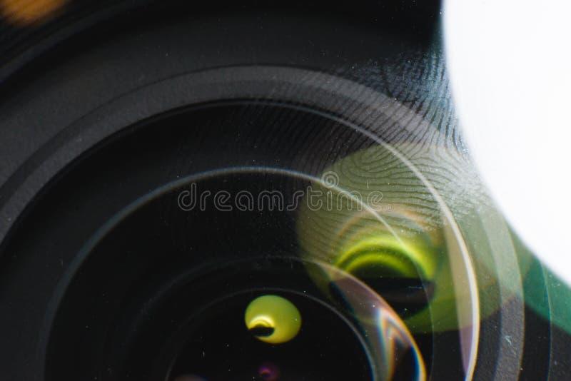 Fingerprint macro on a lens in natural light. Fingerprint scanning, biometrics and security concept stock images