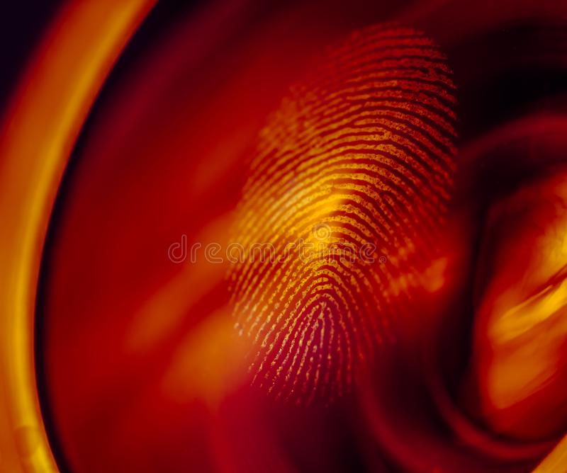 Fingerprint macro on a lens in red light. Shallow depth of field. Biometric and security concept stock photography