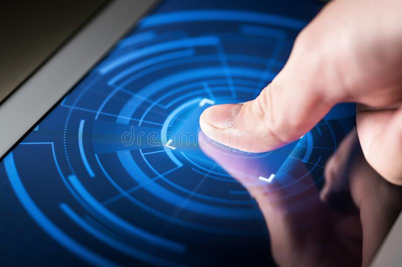 Fingerprint scanner on smart electronic screen. Digital security system technology. High tech biometric cyber protection for online data, identity and stock images