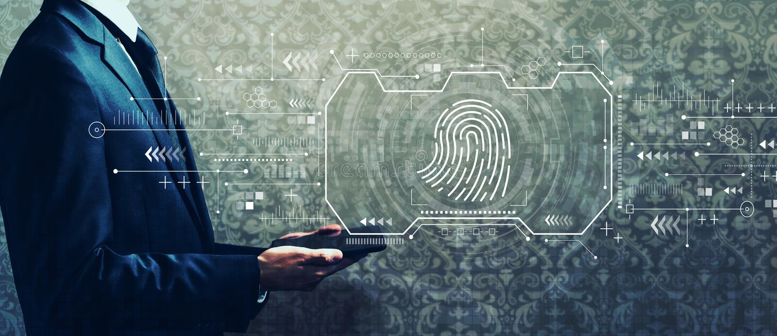 Fingerprint scanning theme with businessman holding a tablet stock photography