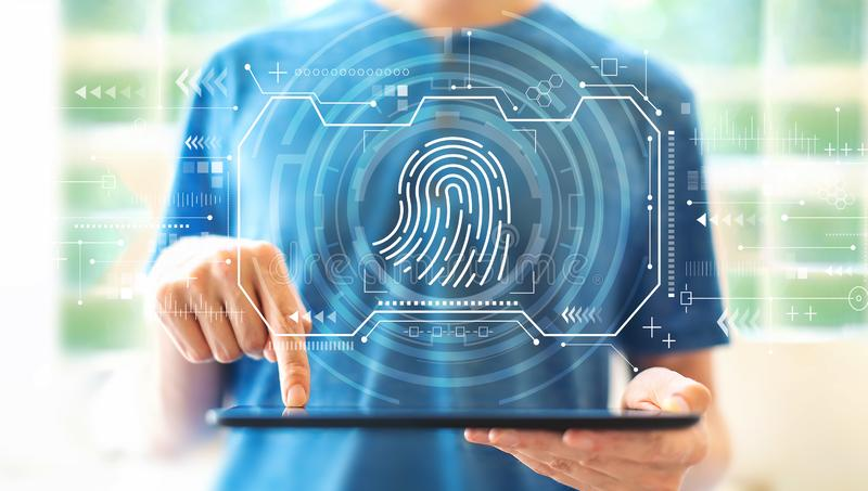 Fingerprint scanning theme with man using a tablet stock photos