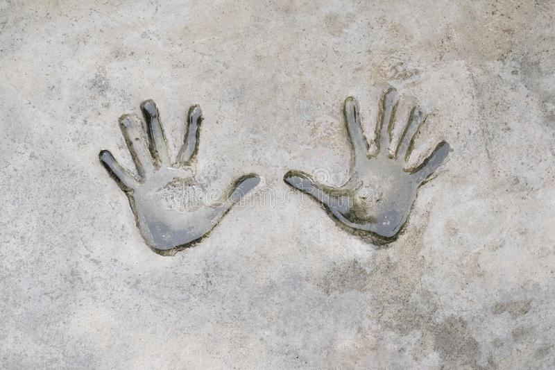 Fingerprints of human on cement. Background and texture of fingerprints. Wet and dirty of fingerprints human on cement. stock image