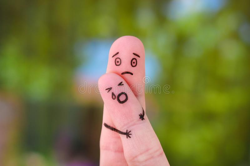 Fingers art of family during quarrel. Concept of child remained with father, baby cries. stock photos