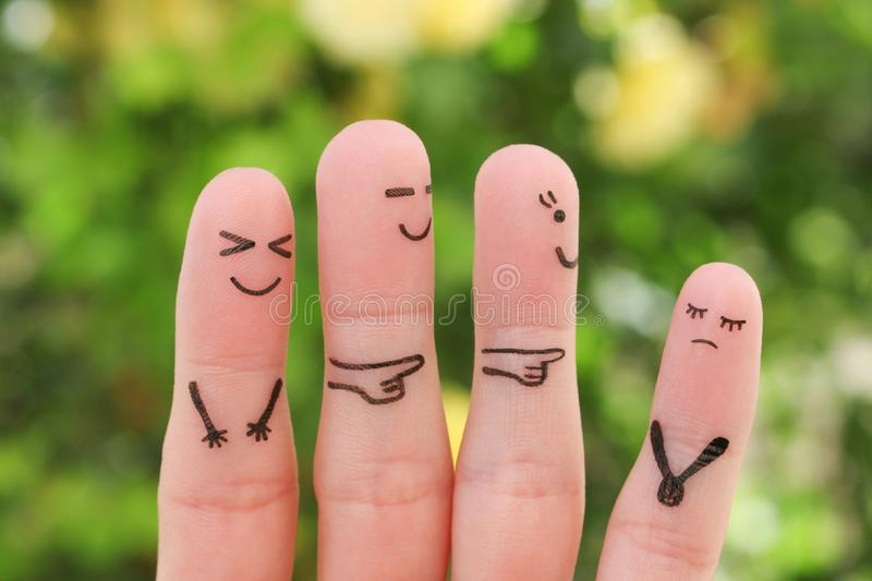 Fingers art of people. Concept children bullying their classmate stock photo