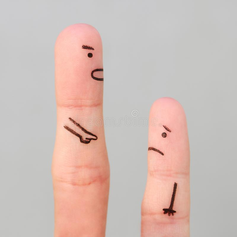 Fingers art of people. Concept of man scolding child.  stock photo