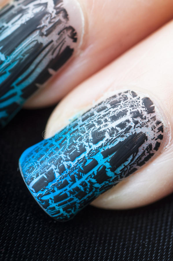 Fingers with craquelure nail polish manicure. Close-up of fingers with craquelure nail polish manicure stock photos