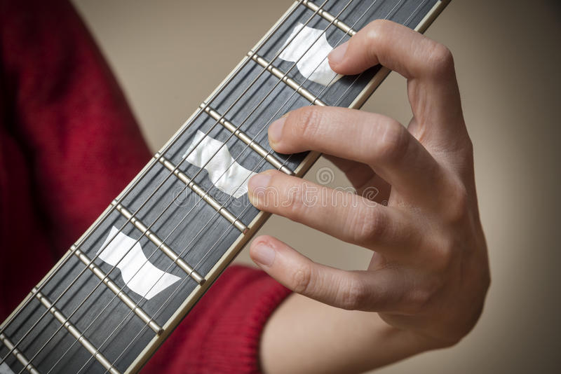 Fingers On Electric Guitar Fretboard Stock Photo - Image of position ...