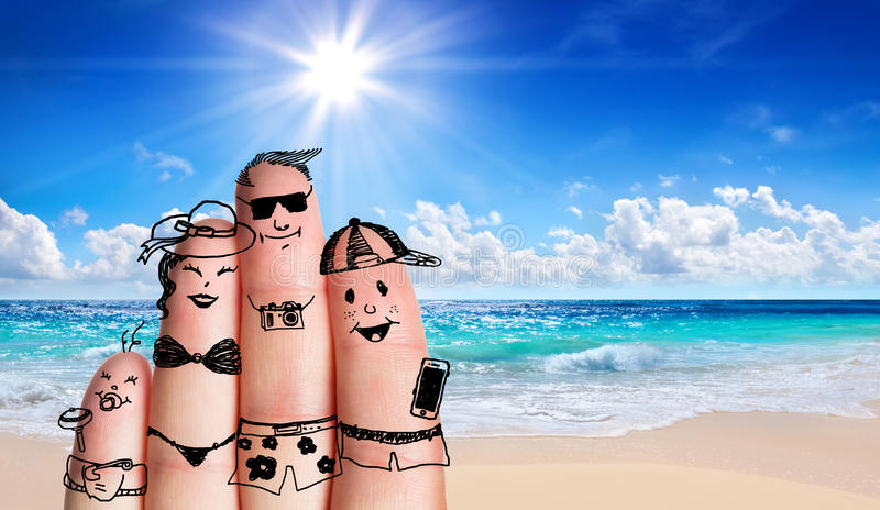 Fingers family on the beach. Summer holiday royalty free stock photo