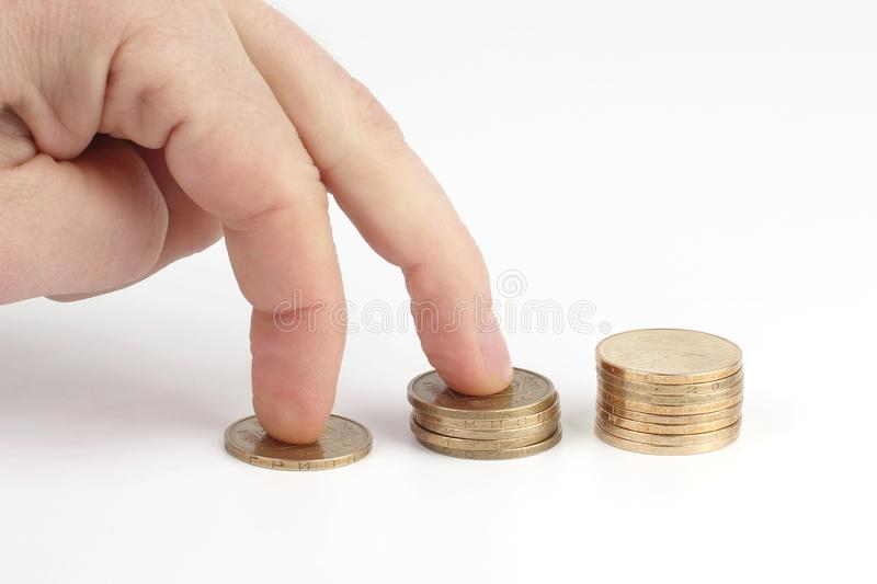 Fingers go up on the coins. cash investment profit growth. The fingers go up on the coins. cash investment profit growth stock image