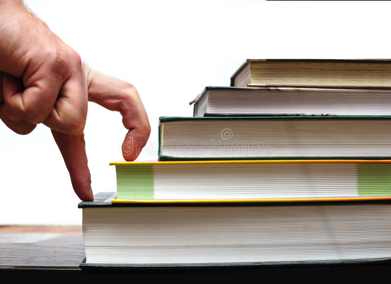 Fingers hand up stairs of books. education concept royalty free stock image