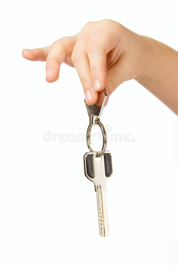 Download Fingers Holding Golden Key Isolated Over White Stock Photo - Image: 7652980