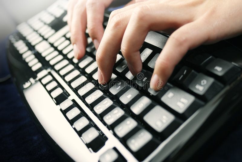 Fingers on keyboard. Writing fingers on PC keyboard royalty free stock photography