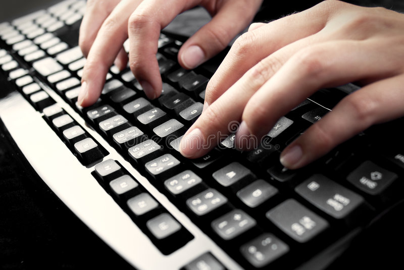 Fingers on keyboard. Writing fingers on PC keyboard royalty free stock photos